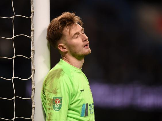 Goalkeeper Bradley Collins reacts after conceding a goal during Burton's heavy defeat (Getty)