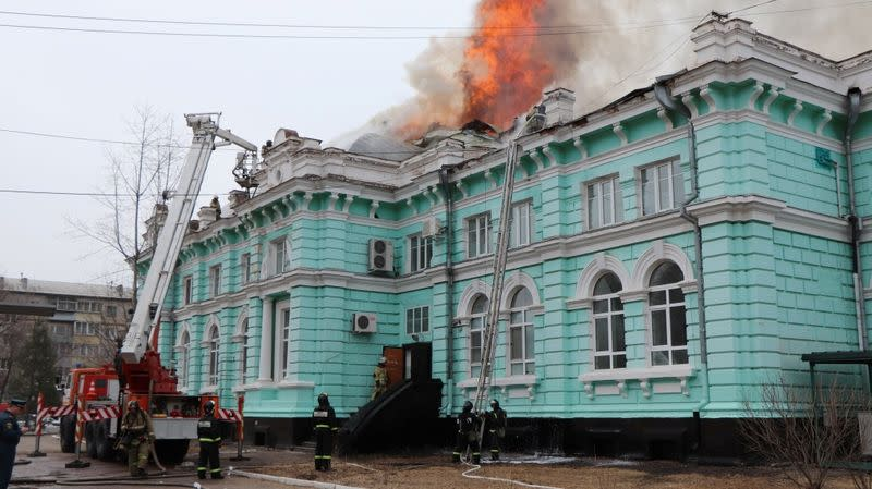 Firefighters work to extinguish a fire at a hospital in Blagoveshchensk