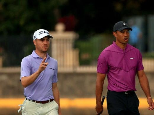 Tiger Woods and  Justin Thomas walk up the 18th hole during the first round of the PNC Championship (Getty)
