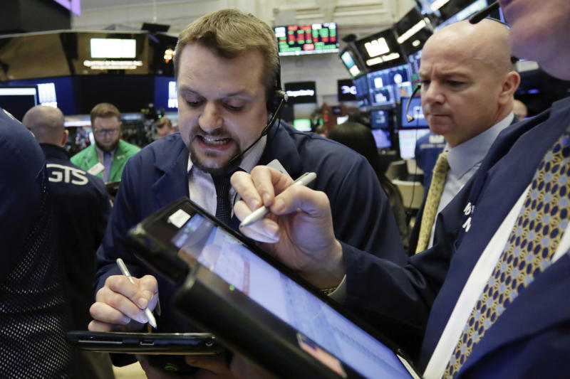 Traders Michael Milano, left, and Patrick Casey work on the floor of the New York Stock Exchange, Friday, Feb. 23, 2018. Stocks are opening higher on Wall Street, led by gains in technology companies and banks. (AP Photo/Richard Drew)