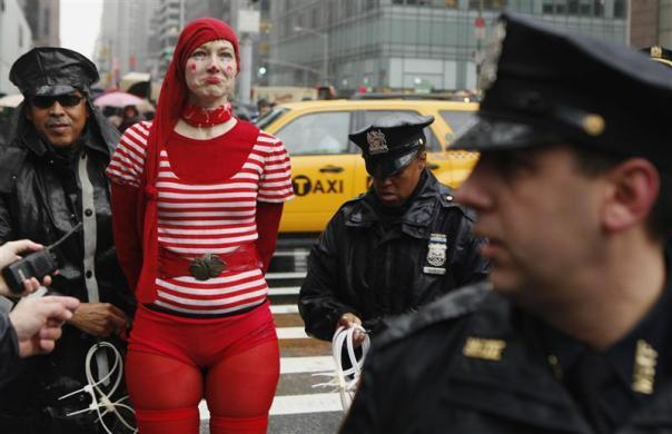 """New York Police Department officers arrest a member of the Occupy Wall St movement during a """"national day of action"""" demonstration by the movement in New York February 29, 2012."""