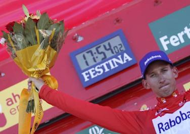 Rabobank Cycling Team's Mollema celebrates after taking the overall lead after the ninth stage of the Tour of Spain