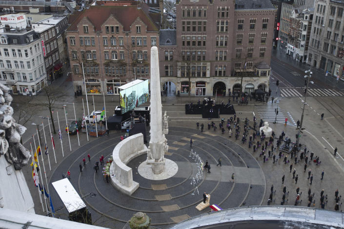 View of Dam Square devoid of spectators due to coronavirus related restrictions, as Dutch King Willem-Alexander and Queen Maxima lay a wreath during a national service to commemorate the war dead in Amsterdam, Netherlands, Tuesday, May 4, 2021. (AP Photo/Peter Dejong, Pool)