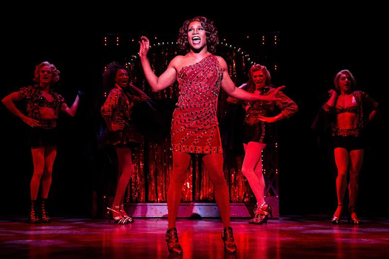 "This theater image released by The O+M Company shows Billy Porter during a performance of ""Kinky Boots."" The Cyndi Lauper-scored ""Kinky Boots,"" based on the 2005 British movie about a real-life shoe factory that struggles until it finds new life in fetish footwear, is nominated for 13 Tony Award nominations.  The awards will be broadcast on CBS from Radio City Music Hall on June 9. (AP Photo/The O+M Company, Matthew Murphy)"