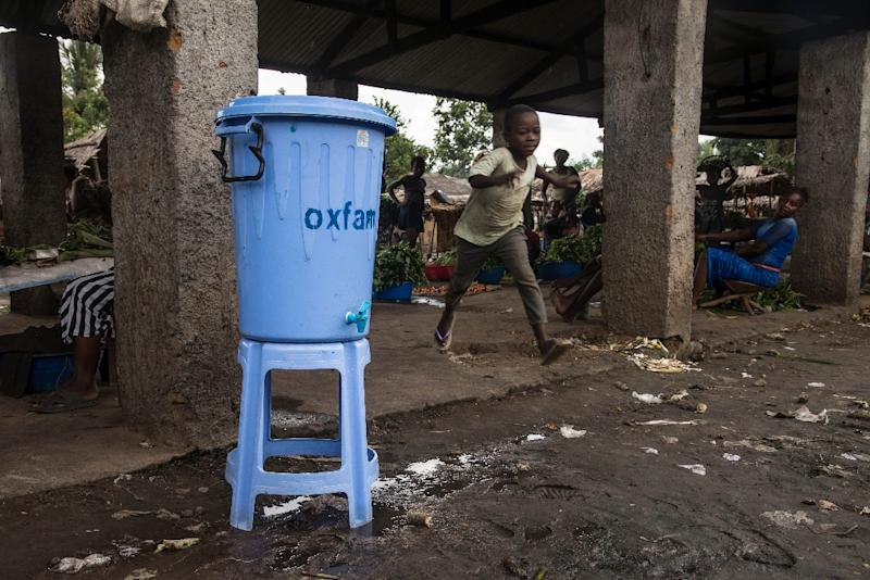 Dispensers containing water mixed with disinfectant are being used in Mbandaka during the Ebola outbreak (AFP Photo/Junior D. KANNAH)