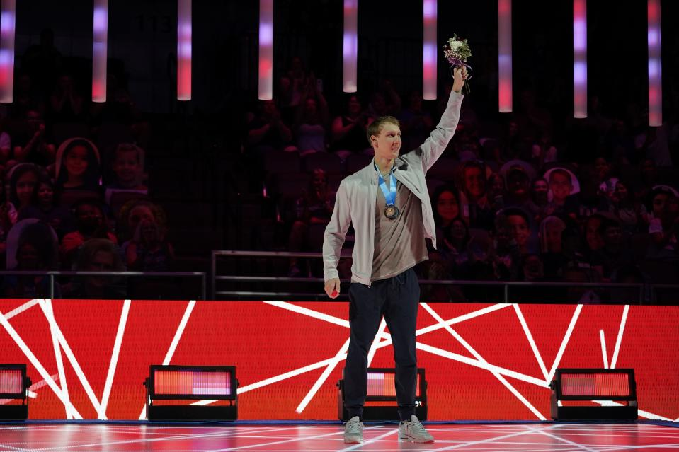 Chase Kalisz waves at the award ceremony after winning the Men's 400 Individual Medley at the U.S. Olympic Swim Trials on Sunday, June 13, 2021, in Omaha, Neb. (AP Photo/Charlie Neibergall)