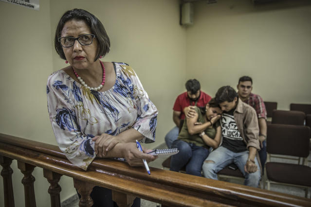 <p>Dina Meza, in court during a hearing where students from the Universidad Nacional Autónoma de Honduras, are on trial following their participation to a demonstration. Dina Meza is a well-known Honduran independent journalist and defender of the right to information and freedom of expression. She works to investigate and denoounce human rights violations in cases such as those of protesting students and other violations of the right to freedom of expression. Meza currently serves as the president of PEN Honduras, and manages the online news magazine Pasos de Animal Grande. Her work as a journalist and human rights defender has resulted in persecution and multiple threats directed towards both Meza herself and towards her family. (Photo: Francesca Volpi) </p>