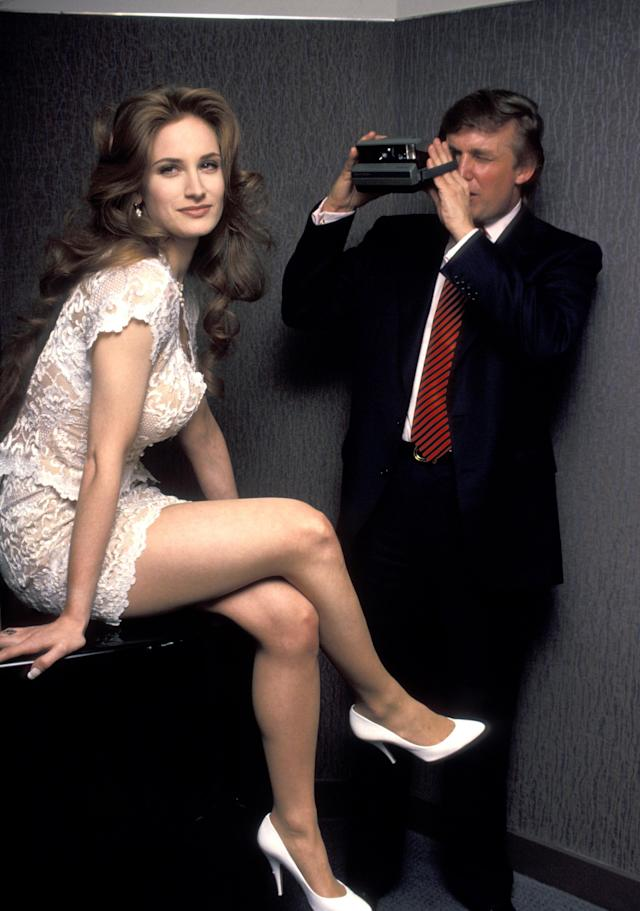 <p>Donald Trump photographs interviewing <em>Playboy</em> centerfold hopeful Bridget during a publicity session in New York, May 3, 1993. (Photo: Ron Galella/WireImage/Getty Images) </p>
