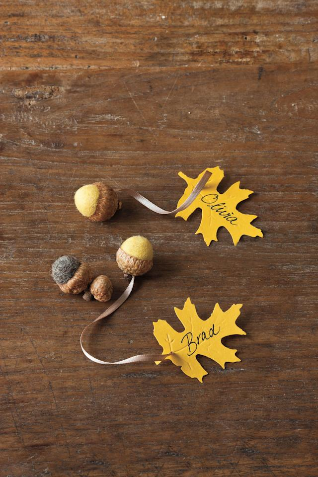 <p>Write the name of each guest on a leaf place card attached to a little felted acorn that doubles as a fun party favor. Scatter loose felted acorns—or real ones—up and down the table to play up the natural theme.</p>