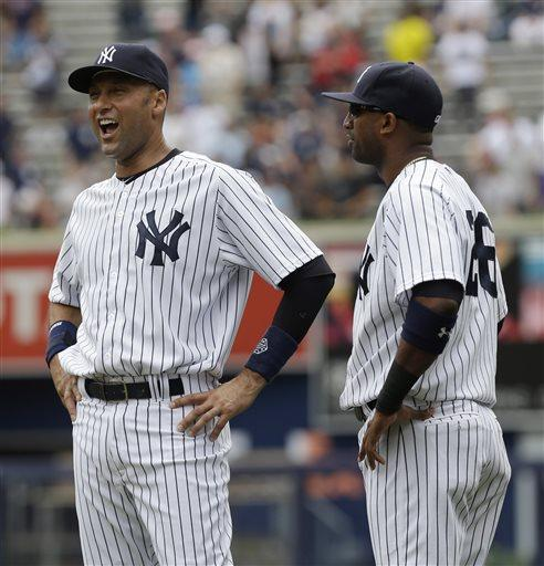 New York Yankees' Derek Jeter, left, and Eduardo Nunez talk before a baseball game against the Kansas City Royals at Yankee Stadium Thursday, July 11, 2013 in New York. (AP Photo/Seth Wenig)