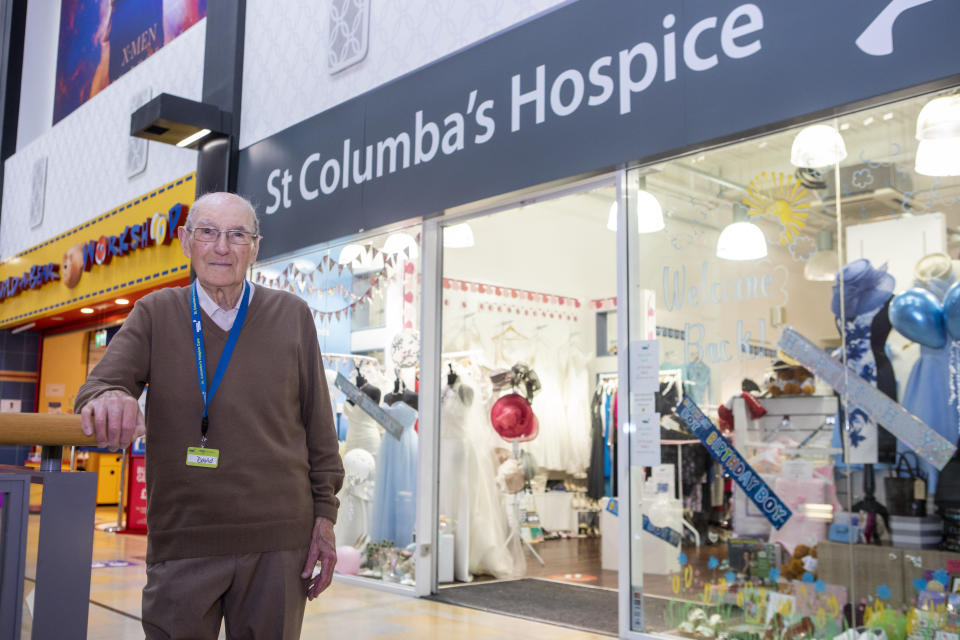 Ninety-nine-year-old David Flucker is still working a four day a week at St Columba's Hospice Charity Shop in Edinburgh. (SWNS)