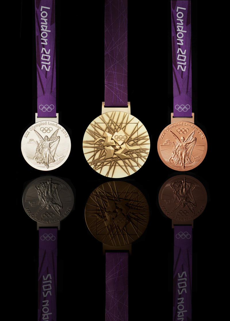 In this image made available by the London Organising Committee of the Olympic  Games on Wednesday July 27, 2011 show the London 2012 Olympic medals designed by British artist David Watkins.  The front of the silver medal is at left, the back of the gold medal at centre and the front of the bronze medal is at right, all medals will be 85mm in diameter. With one year to go until the opening ceremony of the 2012 Olympic Games, London organizers completed the last of the Olympic Park's permanent venues Wednesday July 27, 2011 and promised to put on a safe and spectacular event that will captivate the world. (AP Photo/LOCOG, HO) EDITORIAL USE ONLY