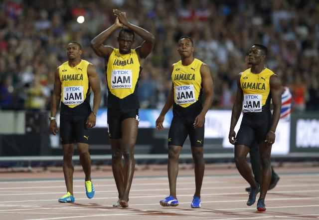 Athletics - World Athletics Championships - Men's 100 Metres Relay Final - London Stadium, London, Britain – August 12, 2017. Omar McLeod, Julian Forte and Yohan Blake and Usain Bolt of Jamaica react after the final. REUTERS/Phil Noble
