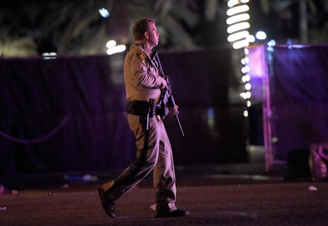 <p>Las Vegas police patrol along the streets outside the the Route 91 Harvest country music festival grounds after a active shooter was reported on Oct. 1, 2017 in Las Vegas, Nevada. (Photo: David Becker/Getty Images) </p>