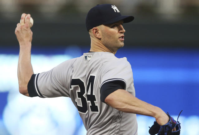 New York Yankees pitcher J.A. Happ throws against the Minnesota Twins in the first inning of a baseball game Monday, Sept. 10, 2018, in Minneapolis. (AP Photo/Jim Mone)