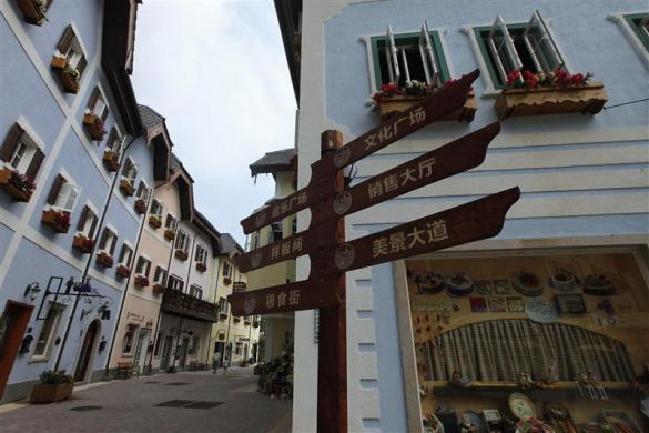 A Chinese road sign is seen at the replica of Austria's UNESCO heritage site, Hallstatt village, in China's southern city of Huizhou in Guangdong province, June 1, 2012.