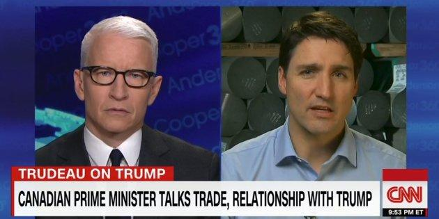 Anderson Cooper and Prime Minister Justin Trudeau are shown in a screegrab from