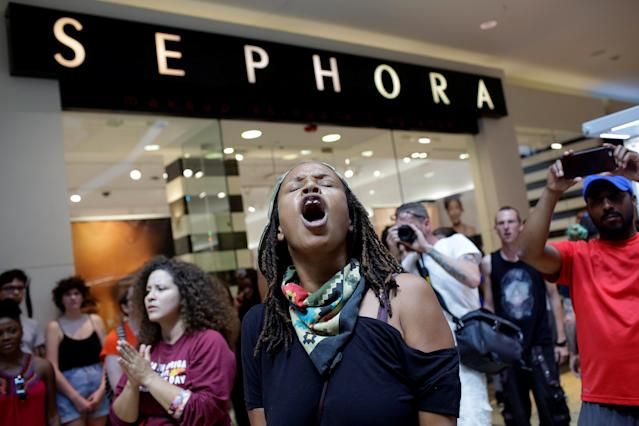 <p>People march through West County Mall a day after the not guilty verdict in the murder trial of Jason Stockley, a former St. Louis police officer, charged with the 2011 shooting of Anthony Lamar Smith, who was black, in St. Louis, Mo., Sept. 16, 2017. (Photo: Joshua Lott/Reuters </p>
