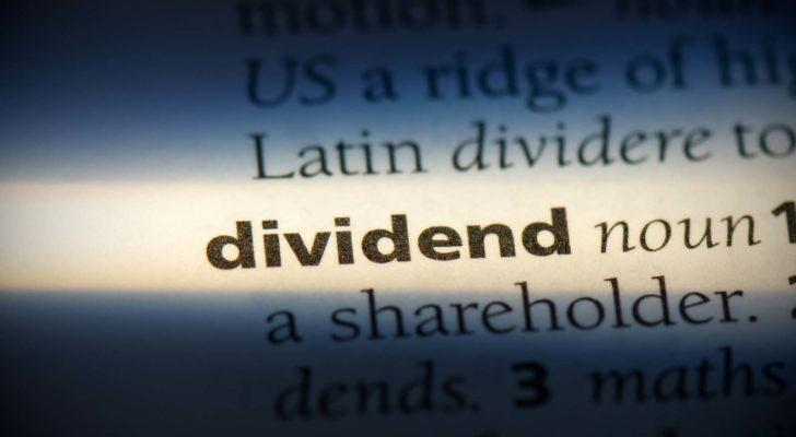 "The word ""dividend"" highlighted in a dictionary."