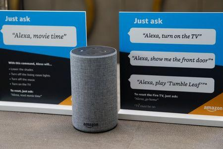 FILE PHOTO - Prompts on how to use Amazon's Alexa personal assistant are seen in an Amazon 'experience centre' in Vallejo