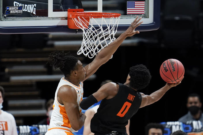 Tennessee guard Yves Pons, left, fouls Oregon State guard Gianni Hunt (0) during the first half of a first round game at Bankers Life Fieldhouse in the NCAA men's college basketball tournament in Indianapolis Friday, March 19, 2021. (AP Photo/Paul Sancya)