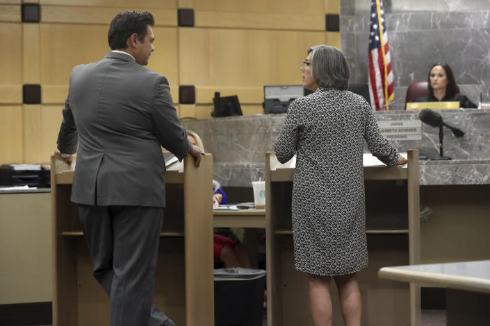 Defense attorney David Wheeler and prosecutor Maria Schneider confer during a pre-trial hearing for Parkland school shooter Nikolas Cruz at the Broward County Courthouse in Fort Lauderdale, Fla., Wednesday, July 14, 2021, on four criminal counts stemming from his alleged attack on a Broward jail guard in November 2018. Cruz is accused of punching Sgt. Ray Beltran, wrestling him to the ground and taking his stun gun. (Amy Beth Bennett/South Florida Sun-Sentinel via AP, Pool)