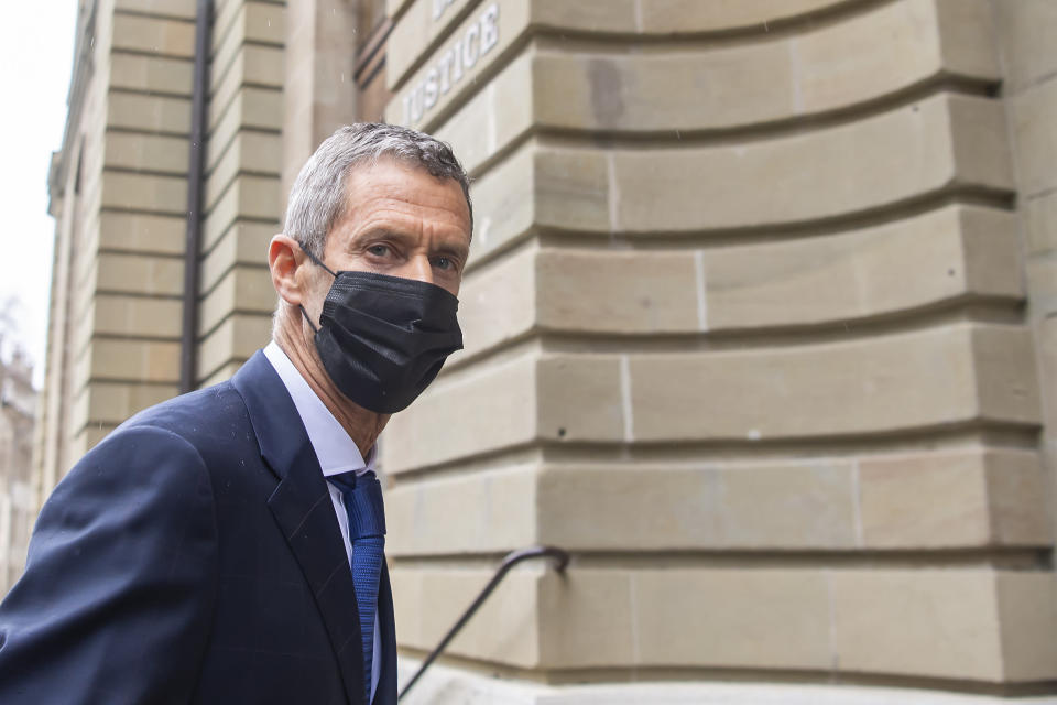 Israeli businessman and diamond-magnate, Beny Steinmetz, arrives to Geneva's courthouse for the reading of his verdict for alleged corruption of Guinean public officials and forgery documents, in Geneva, Switzerland, Friday, Jan. 22, 2021. (Martial Trezzini/Keystone via AP)