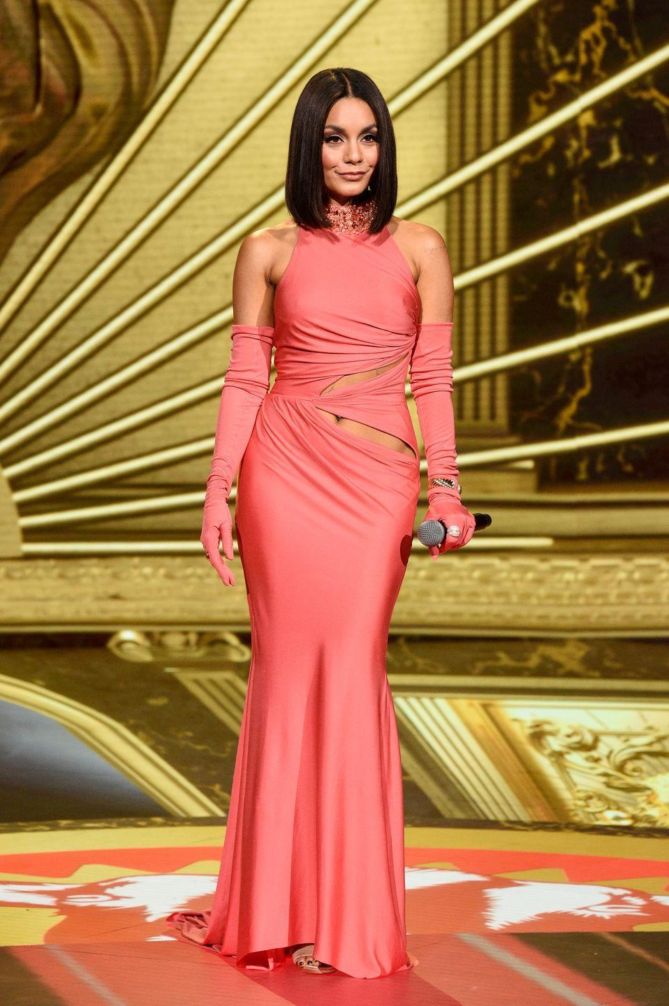 <p><strong>6 December </strong>The evening's host, Vanessa Hudgens, wore a salmon-pink couture gown by Tony Ward, with matching gloves.</p>