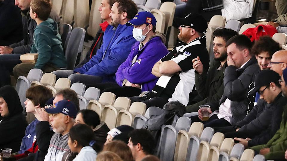 A fan at Optus Stadium, pictured here wearing a mask.