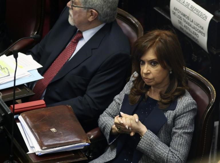 Photo released by Noticias Argentinas of former Argentine president Cristina Kirchner (R) at a special session of the Senate in Buenos Aires on August 22, 2018