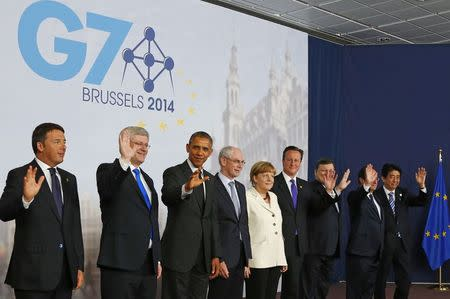 (L-R) Italy's Prime Minister Matteo Renzi, Canada's Prime Minister Stephen Harper, U.S. President Barack Obama, European Council President Herman Van Rompuy, Germany's Chancellor Angela Merkel, Britain's Prime Minister David Cameron, European Commission President Jose Manuel Barroso, France's President Francois Hollande and Japan's Prime Minister Shinzo Abe pose for a group photo during a G7 leaders meeting at European Council headquarters in Brussels June 5, 2014. REUTERS/Yves Herman