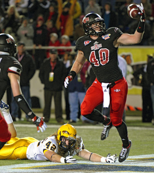 Arkansas State linebacker Nathan Herrold (40) reaches out to intercept a pass in the end zone intended for Kent State tight end Tim Erjavec (42) in the second quarter of the GoDaddy.com Bowl NCAA college football game in Mobile, Ala., Sunday, Jan. 6, 2013. (AP Photo/G.M. Andrews)