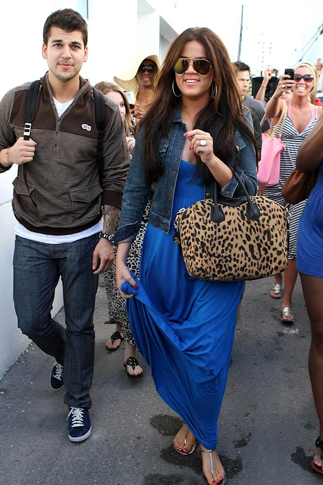 "Amidst much fanfare, Khloe Kardashian and her little brother Rob stopped by the family's Dash store in Miami, Florida, on Wednesday, before heading over to Wet Willie's bar for frozen drinks. <a href=""http://www.infdaily.com"" target=""new"">INFDaily.com</a> - March 9, 2011"