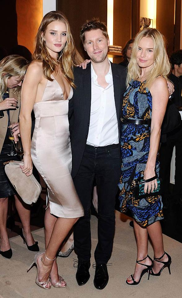 The face of the Burberry Body campaign, model and actress Rosie Huntington-Whiteley (left), let it all hang out as she cozied up with Burberry's chief creative officer and actress Kate Bosworth at the event.  (10/26/2011)
