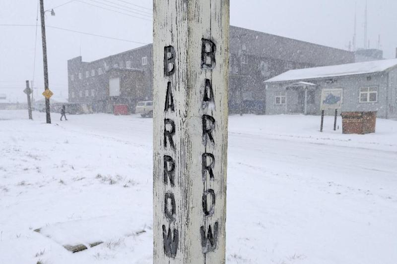 FILE - In this Oct. 10, 2014, file photo, snow falls around a sign in Barrow, Alaska. A court hearing is set for Thursday, March 9, 2017, in Alaska for the two sides in a lawsuit challenging the new Inupiat Eskimo name of the nation's northernmost town. A judge in Alaska has dealt a legal blow to opponents of the new Inupiat Eskimo name approved by voters in the nation's northernmost town. Superior Court Judge Paul Roetman on Friday, March 10, 2017, denied a request to halt implementation of the transition from the old name of Barrow to Utqiagvik until a lawsuit filed by a local Alaska Native corporation is resolved. (AP Photo/Gregory Bull, File)
