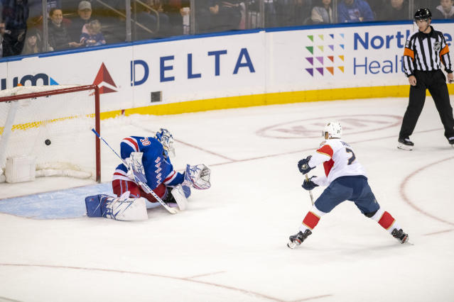 Florida Panthers center Vincent Trocheck (21) scores the winning goal on New York Rangers goaltender Henrik Lundqvist (30) during a shootout of a NHL hockey game, Sunday, Nov. 10, 2019, in New York. (AP Photo/Corey Sipkin)