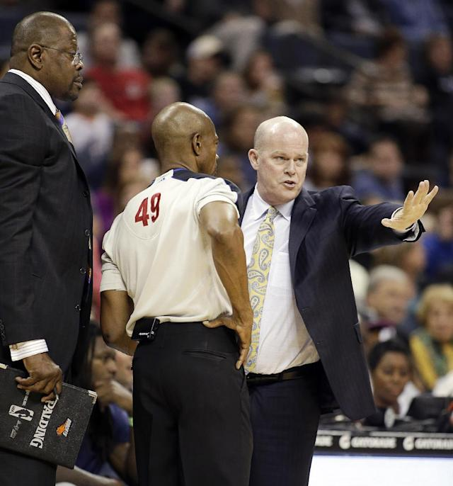Charlotte Bobcats' associate head coach Patrick Ewing, left listens in as head coach Steve Clifford explains his side to referee Tom Washington (49) after being called for a technical against the Houston Rockets during the first half of an NBA basketball game in Charlotte, N.C., Monday, March 24, 2014. (AP Photo/Bob Leverone)
