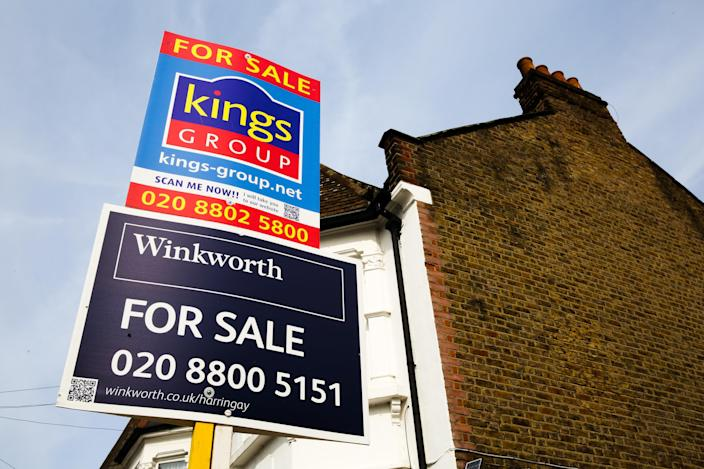 Estate agents property for sale boards on display outside a residential property in north London. Photo: Dinendra Haria / SOPA Images/Sipa USA