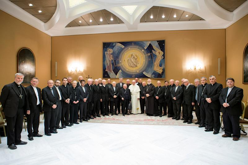 Pope Francis poses with Chilean bishops after a meeting at the Vatican on May 17. (Osservatore Romano / Reuters)