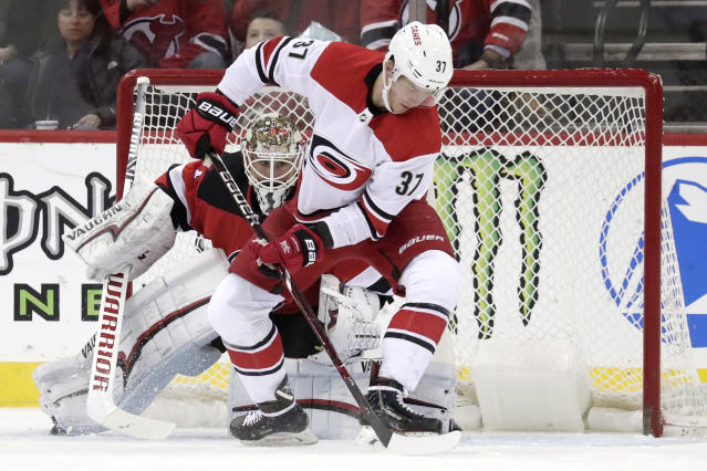 Carolina Hurricanes right wing Andrei Svechnikov (37), of Russia, attacks as New Jersey Devils goaltender Keith Kinkaid (1) protects his net during the second period of an NHL hockey game, Sunday, Feb. 10, 2019, in Newark, N.J. (AP Photo/Julio Cortez)