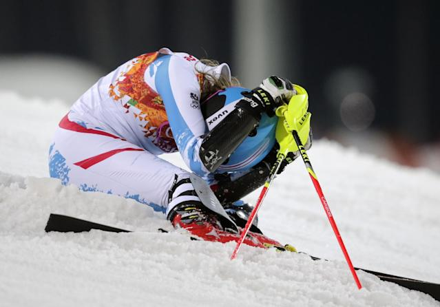 Austria's Bernadette Schild reacts after skiing out of the second run in the women's slalom at the Sochi 2014 Winter Olympics, Friday, Feb. 21, 2014, in Krasnaya Polyana, Russia. (AP Photo/Charles Krupa)