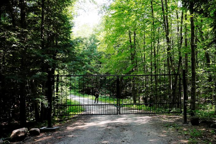 A locked gate blocked the driveway to the property on Thursday.