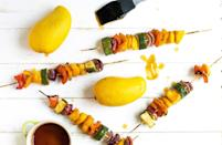 """<p>Fruit deserves some grilling love too. These mango skewers will add some much-needed color and flavor to your vegetable grilling this year. Embrace the sweetness from the diced mangoes, bell pepper, zucchini and red onion, which are coated in a tangy teriyaki glaze, creating the perfect summertime dish.</p> <p><a href=""""https://www.thedailymeal.com/recipe/teriyaki-mango-skewers?referrer=yahoo&category=beauty_food&include_utm=1&utm_medium=referral&utm_source=yahoo&utm_campaign=feed"""" rel=""""nofollow noopener"""" target=""""_blank"""" data-ylk=""""slk:For the Grilled Teriyaki Mango Skewers recipe, click here."""" class=""""link rapid-noclick-resp"""">For the Grilled Teriyaki Mango Skewers recipe, click here.</a></p>"""