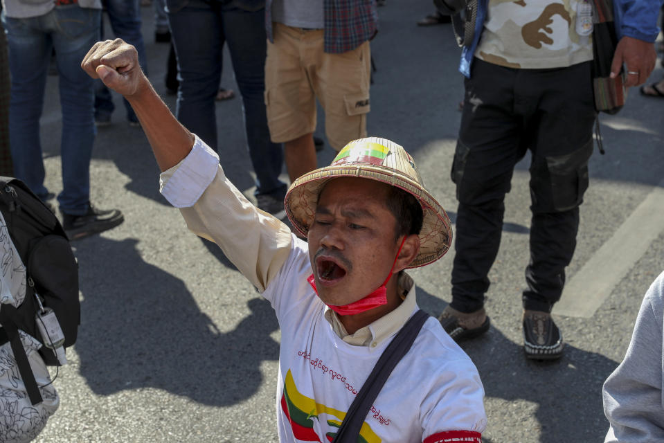An anti-coup protester shouts slowgans after riot policemen blocked their march in Mandalay, Myanmar, Wednesday, Feb. 24, 2021. Protesters against the military's seizure of power in Myanmar were back on the streets of cities and towns on Wednesday, days after a general strike shuttered shops and brought huge numbers out to demonstrate. (AP Photo)