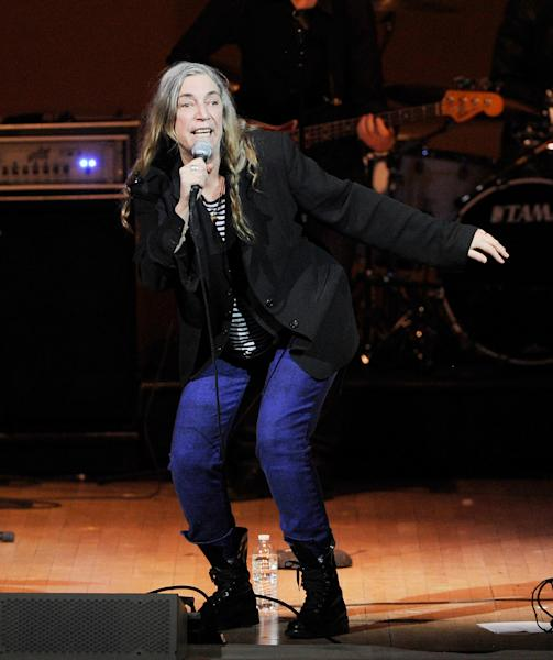 Singer-songwriter Patti Smith performs at the 24th Annual Tibet House U.S. benefit concert at Carnegie Hall on Tuesday, March 11, 2014 in New York. Photo by Evan Agostini/Invision/AP)