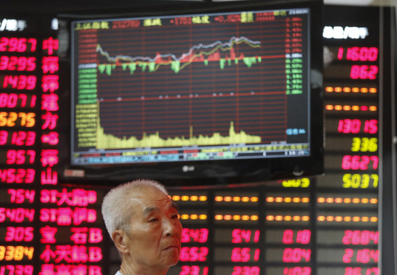 An investor looks at a stock price monitor at a private securities company Friday Sept. 14, 2012 in Shanghai, China. Asian stock markets bounded higher Friday after investors got just what they wanted — big moves by the Federal Reserve to help the U.S. economy out of its funk. (AP Photo)