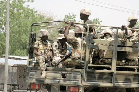 Soldiers are seen on a truck in Maiduguri in Borno State, Nigeria