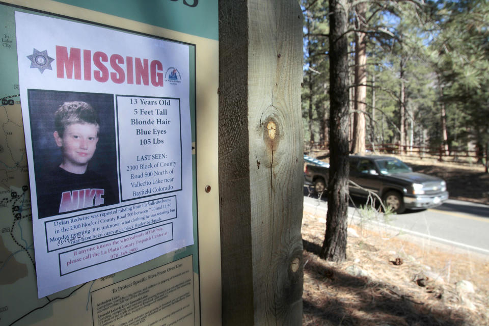 FILE - In this Nov. 26, 2012, file photo, a missing poster of 13-year-old Dylan Redwine hangs on a trail head sign next to Vallecito Reservoir in Vallecito, Colo. Prosecutors told a jury in closing arguments Thursday, July 15, 2021, that a Colorado father charged with killing his son almost a decade ago committed the deed after the 13-year-old boy learned things about his father that ultimately ruined their relationship. Mark Redwine, 59, is on trial on charges of second-degree murder and child abuse resulting in the death of Dylan Redwine. (Shaun Stanley/The Durango Herald via AP, File)