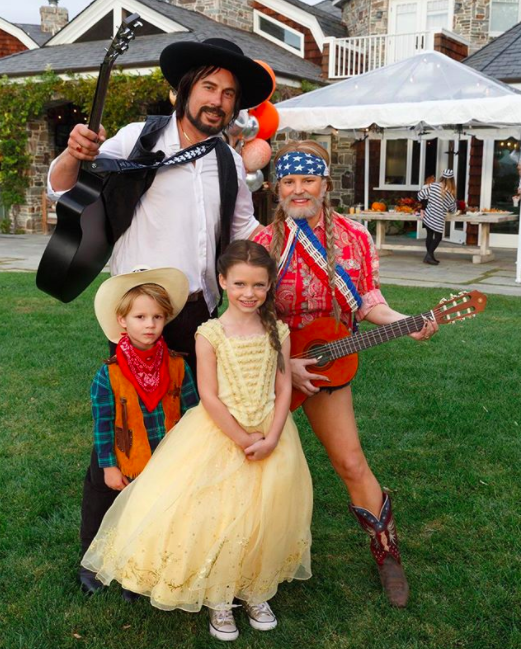 """<p>The singer turned fashionista went as her <em>Dukes of Hazzard</em> co-star and friend Willie Nelson (beard, braids, and all) as her hubby, Eric Johnson, kept with the music theme as Waylon Jennings. Their kids, Ace and Maxwell, were """"Cowboy Ace and Belle."""" (Photo: <a href=""""https://www.instagram.com/p/Ba7v5sWgFYQ/?hl=en&taken-by=jessicasimpson"""" rel=""""nofollow noopener"""" target=""""_blank"""" data-ylk=""""slk:Jessica Simpson via Instagram"""" class=""""link rapid-noclick-resp"""">Jessica Simpson via Instagram</a>) </p>"""
