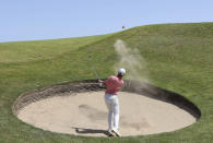 Northern Ireland's Rory McIlroy plays out of bunker on the 11 green during the third round of the British Open Golf Championship at Royal St George's golf course Sandwich, England, Saturday, July 17, 2021. (AP Photo/Ian Walton)